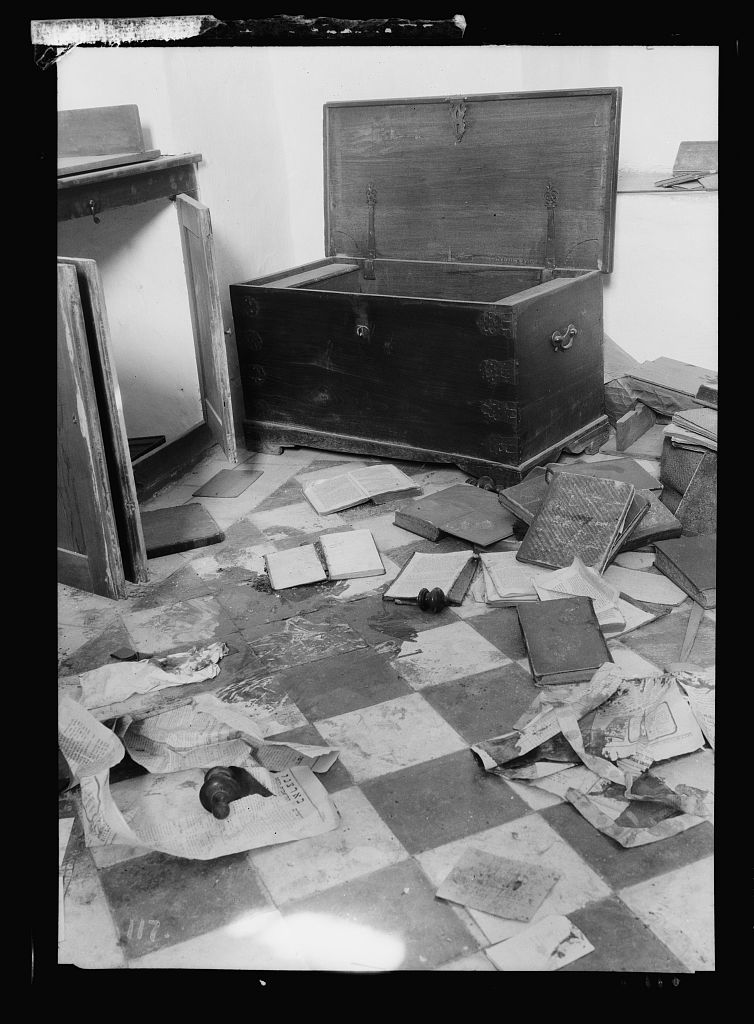 Palestine events. The 1929 riots, August 23 to 31. Jewish home plundered by Arab rioters in Hebron. Blood-stained floor littered with books
